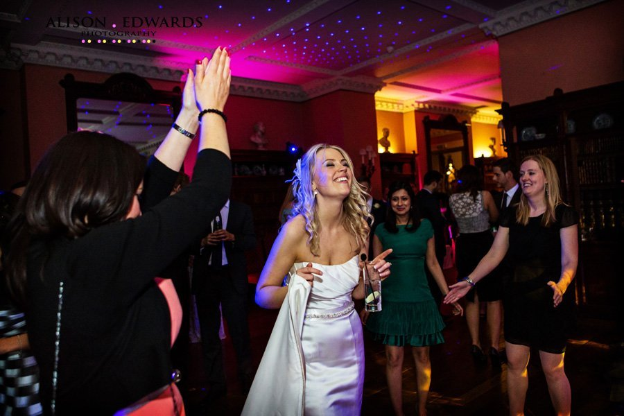 Prestwold Hall wedding photography of bride dancing with guests