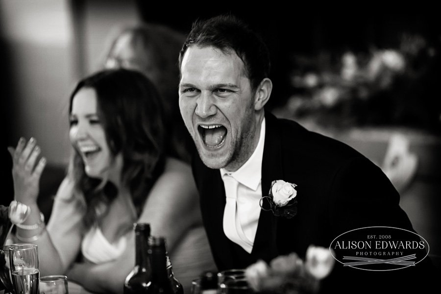 funny wedding speeches - bride and groom laughing at the best man's speech