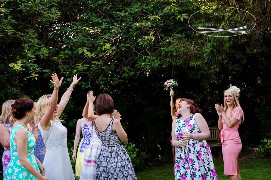Old Vicarage Boutique Wedding throwing the bouquet