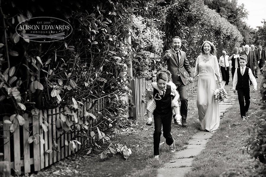 walking from church wedding laughing at children