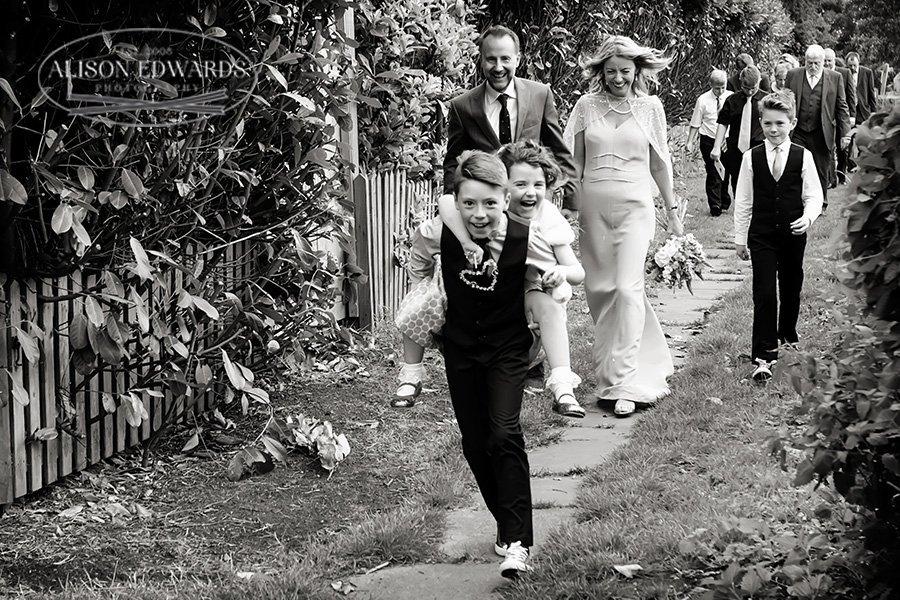 walking from church wedding children laughing