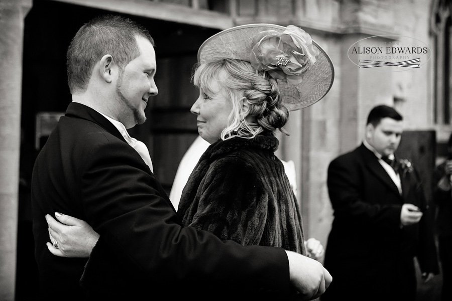 mother and groom moment outside of church