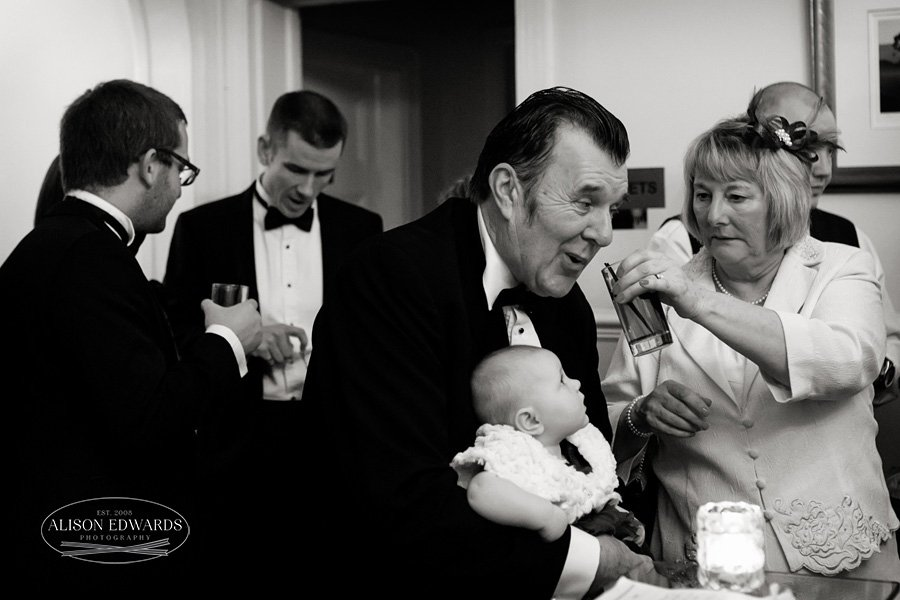 guests with baby at wedding reception