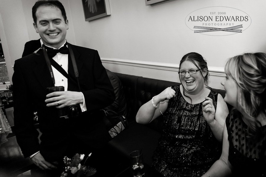 guest laughing during drinks reception at wedding