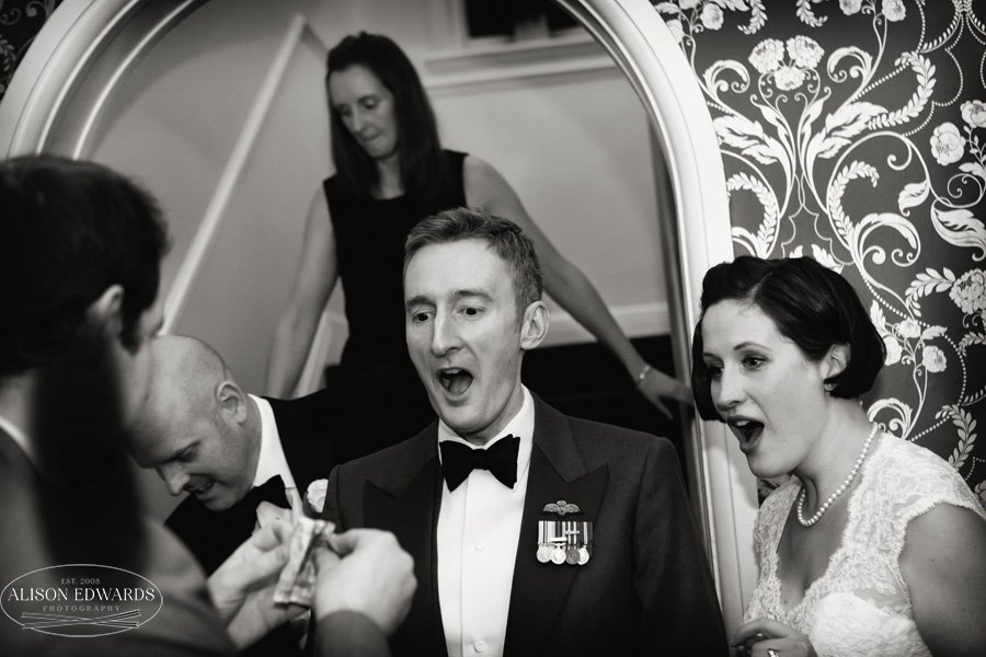 bride and groom with magician looking shocked