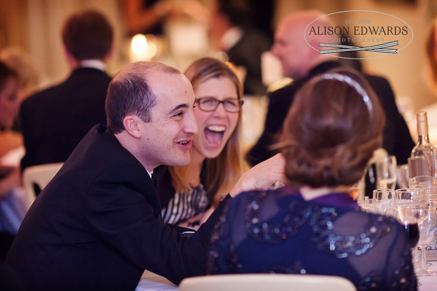 guests laughing during wedding speeches