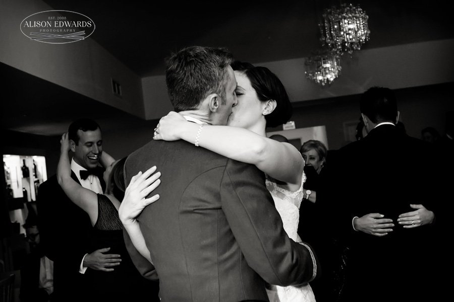 bride and groom's kissing during first dance