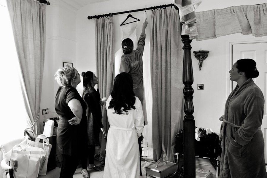 bridesmaid getting wedding dress for bride at Newark Town & District Club