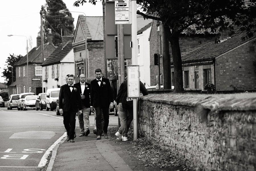 groomsmen walking to St Giles Church in Newark