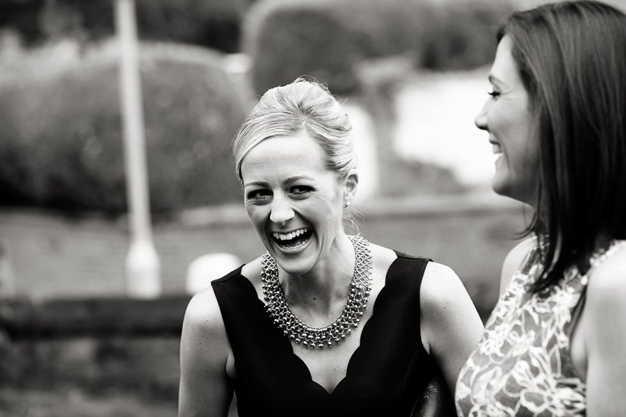 wedding guest laughing at St. Gile's Church Newark