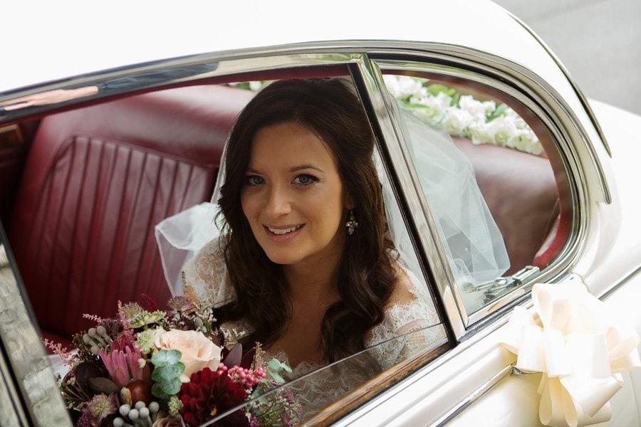 bride arriving at church in wedding car