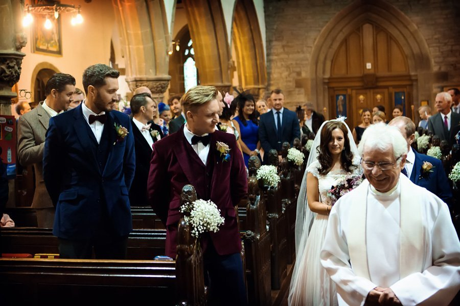 groom's first look of bride walking into church at Newark