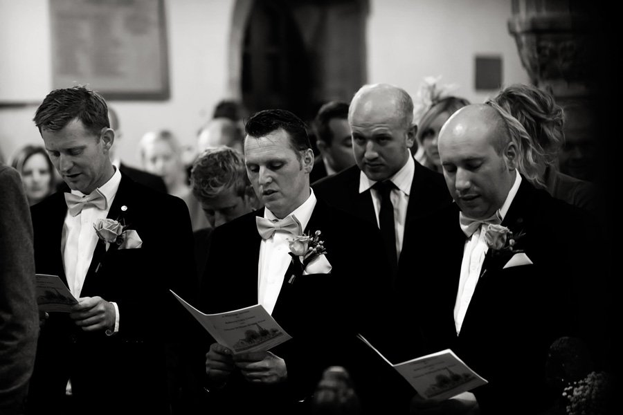 groomsmen singing at church in Newark