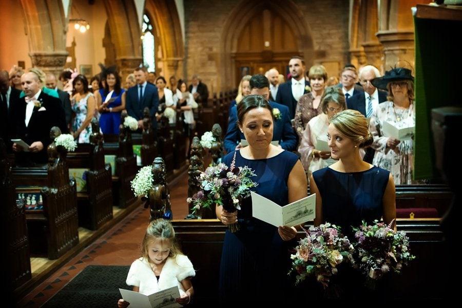 bridesmaid and flower girl singing in church Newark