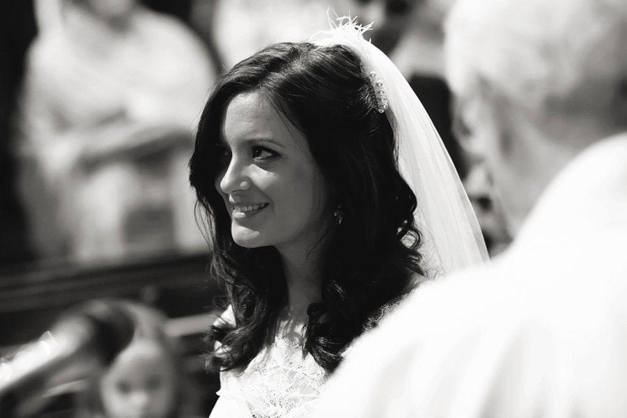 bride smiling looking towards groom