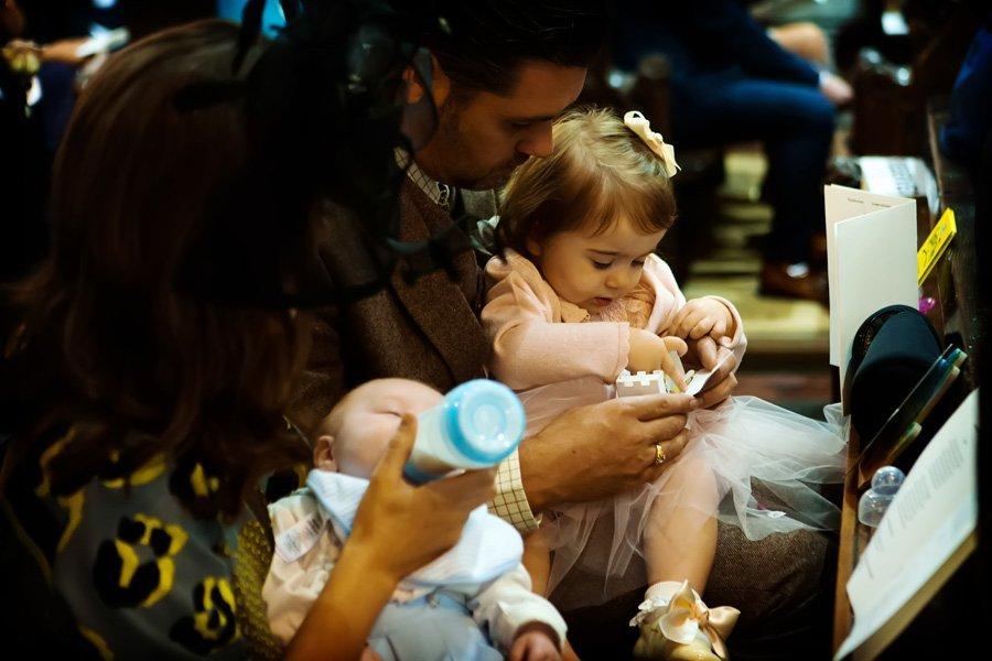 children being fed in church at wedding