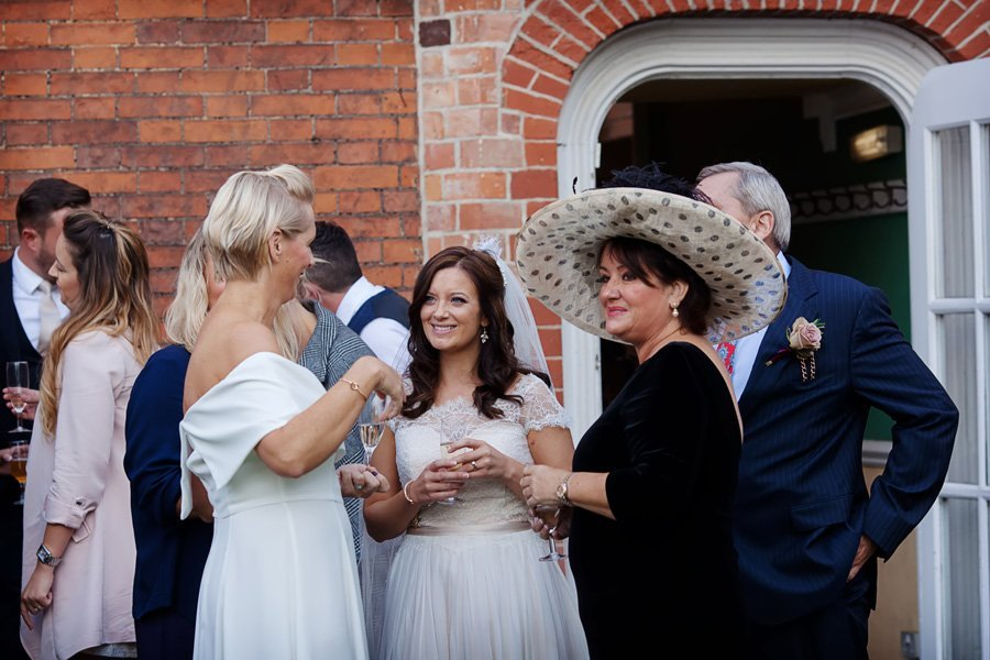 bride and guests talking outside of Newark Town & District Club