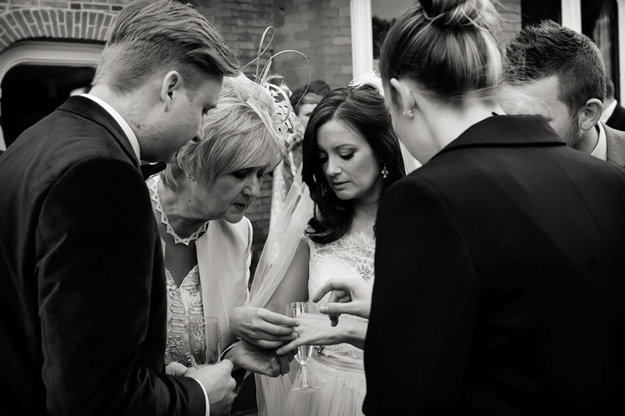 bride showing guests wedding ring
