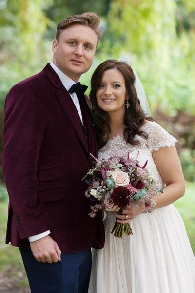 bride and groom portrait with autumn bouquet