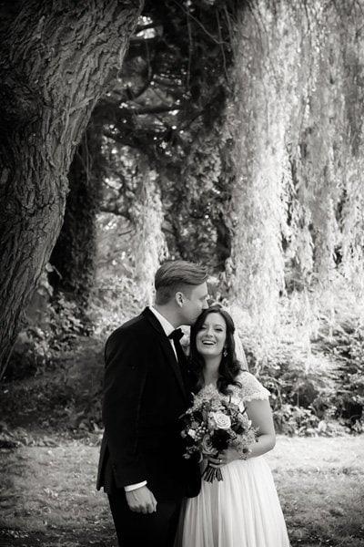 bride and groom in gardens at wedding venue