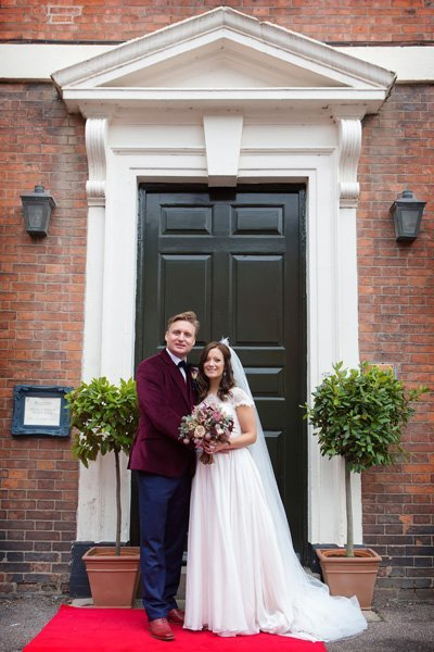 bride and groom in front of Newark Town & District Club