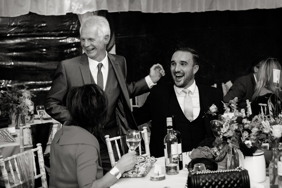 guests laughing at evening reception