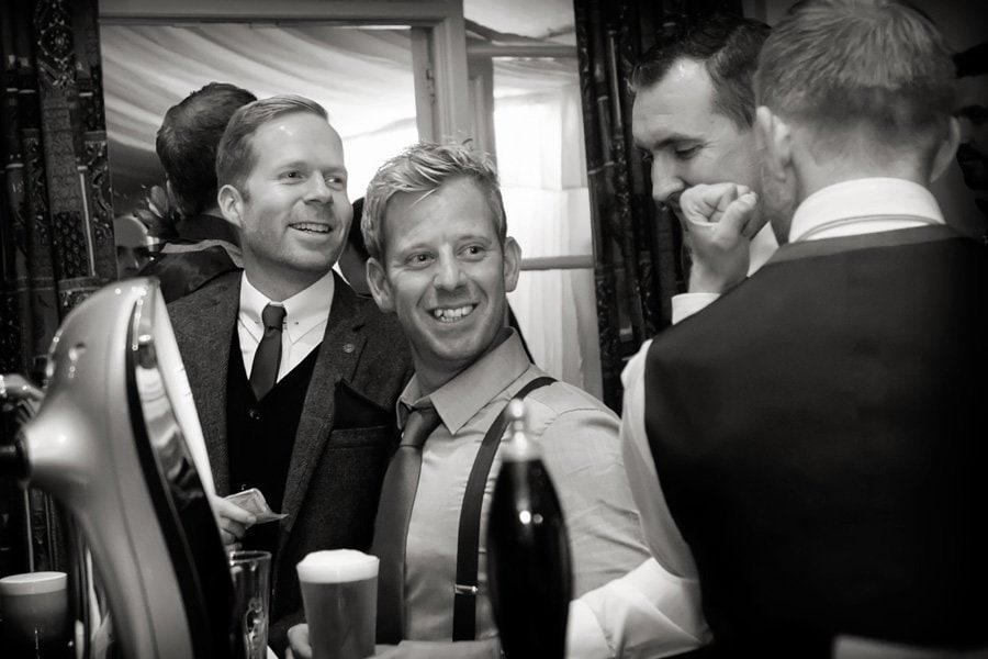 wedding guests at bar in Newark Town & District Club Newark