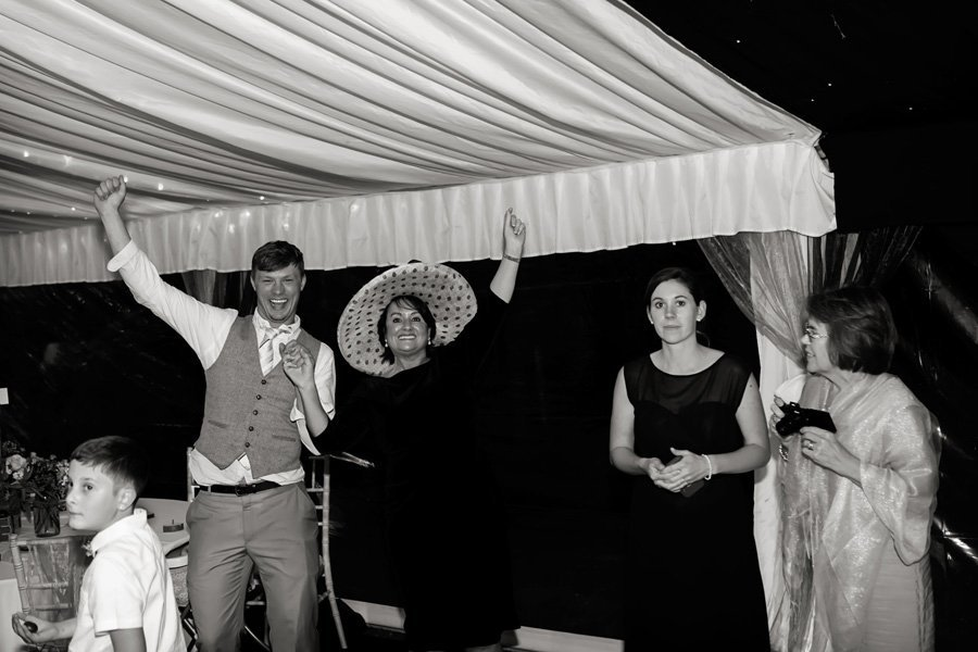 wedding guests having fun dancing at wedding