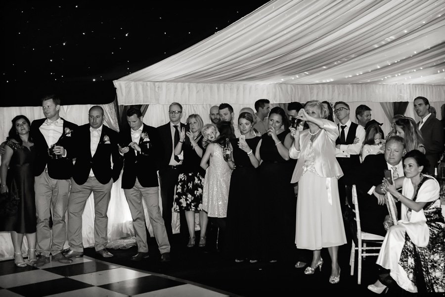 wedding guests in marquee watching first dance