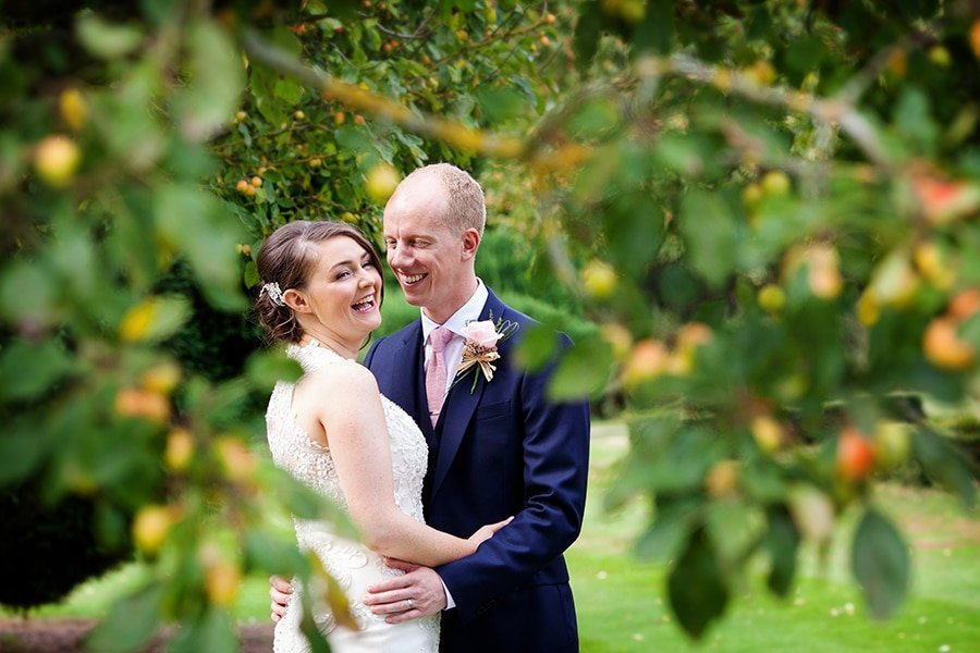 bride and groom laughing at norwood park