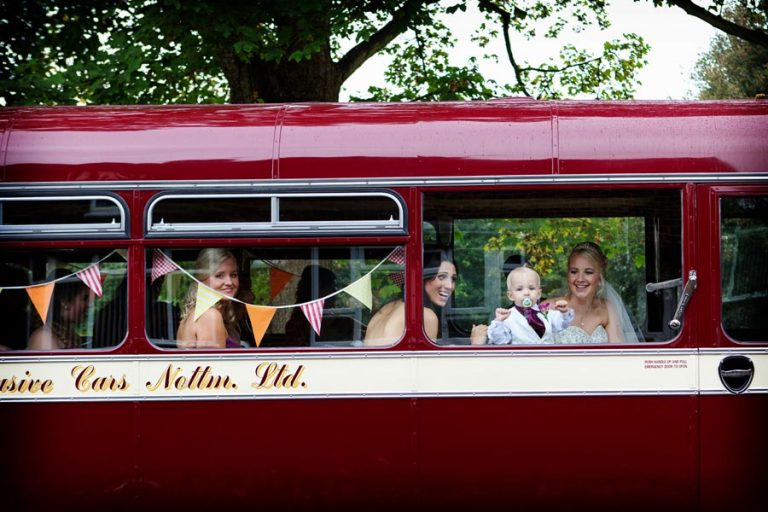 bride and guest on bus from church to venue