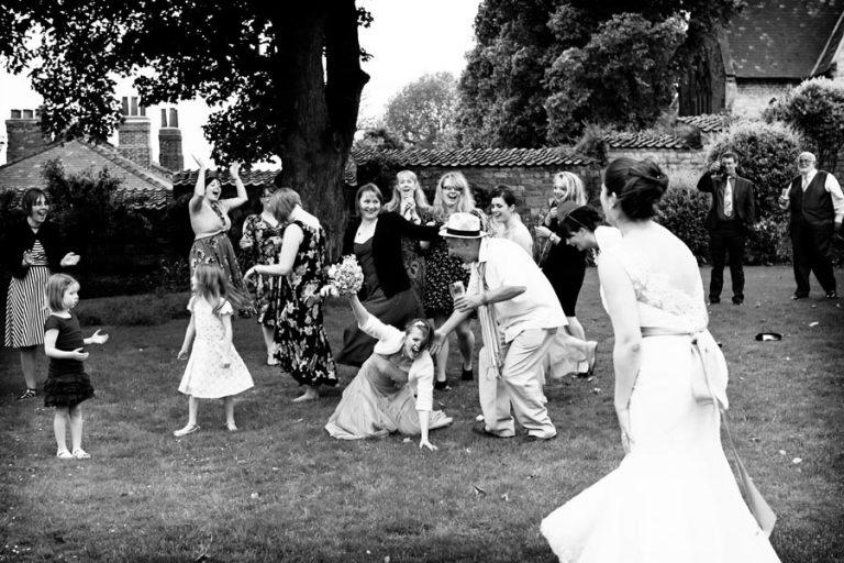 guest catching bride's bouquet