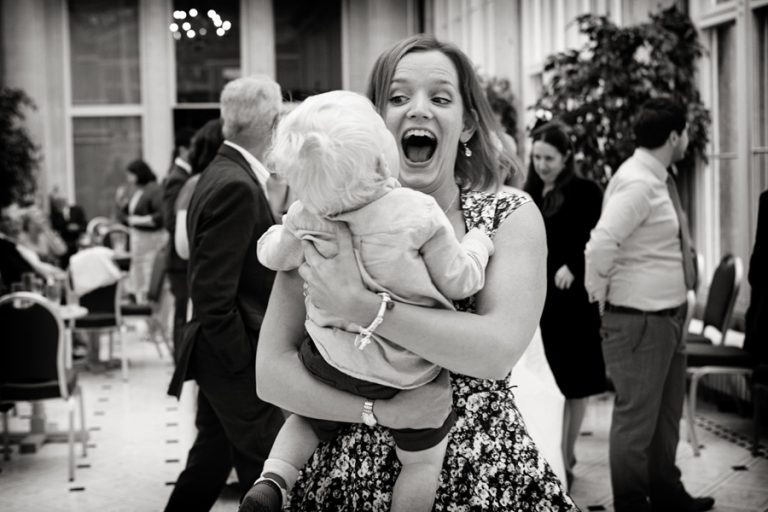 lady laughing with boy at wedding