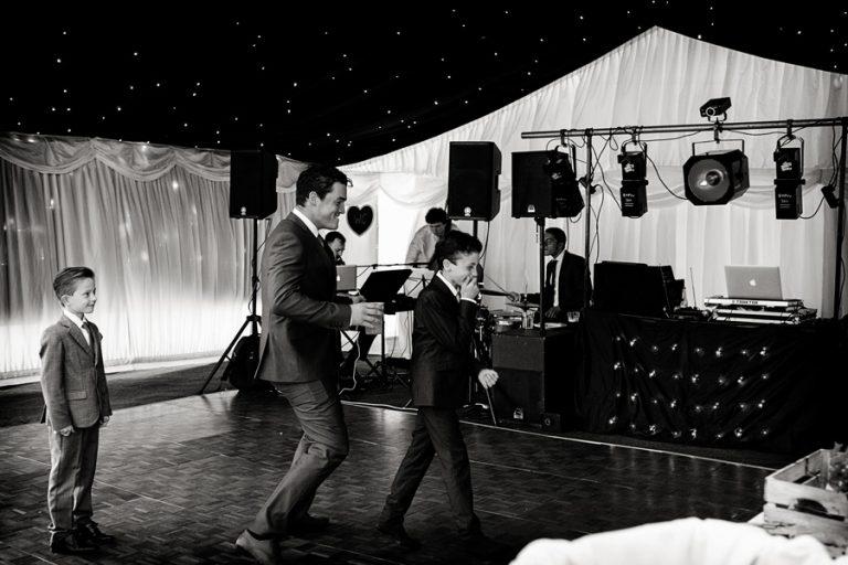 wedding-photography-dancing-guest-chasing boy on dance floor