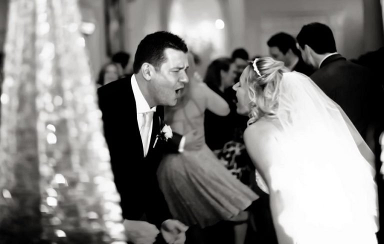 bride and groom signing and dancing on dance floor