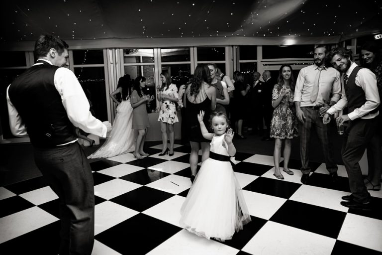 girl in middle of dance floor at Norwood Park wedding