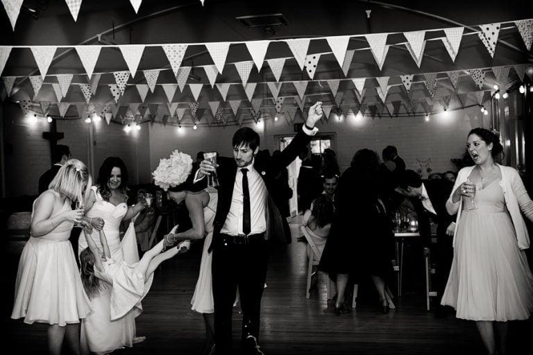guests dancing in village hall wedding