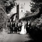 """Bridal party walking from church – """"Hey, remember this?"""""""