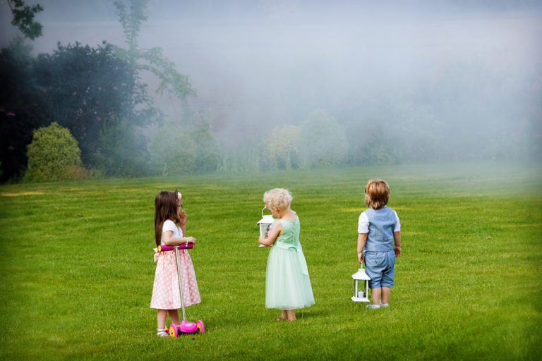 children staring at smoke coming from trees at Kelham House