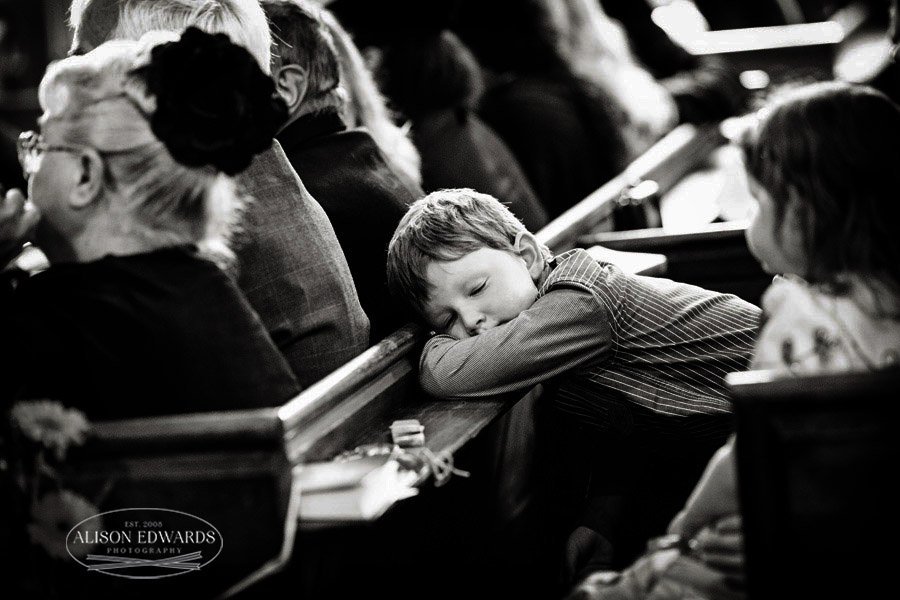 boy falling asleep in the ceremony at church