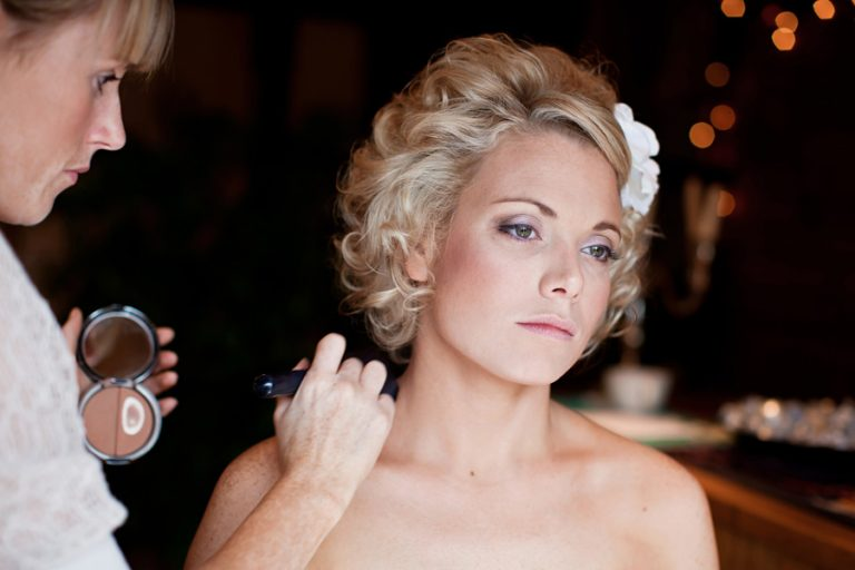 bride looking thoughtful whilst having make-up done