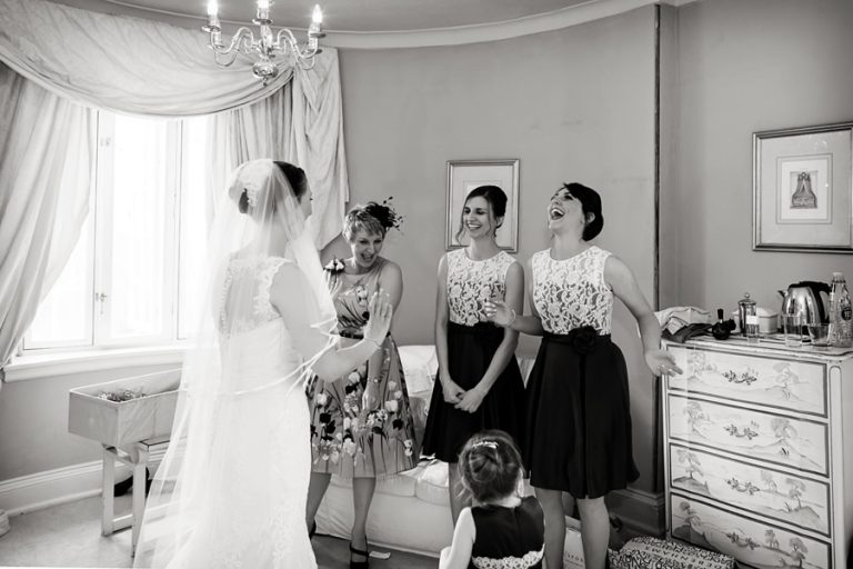 bridesmaids laughing with bride before ceremony