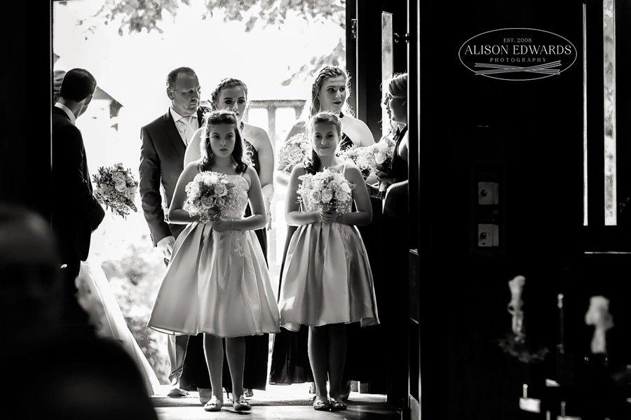 bridesmaids waiting at the top of the aisle