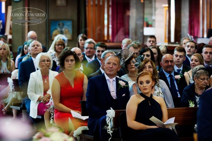 wedding guests i church watching marriage