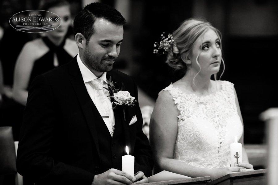 bride and groom kneeling during wedding ceremony