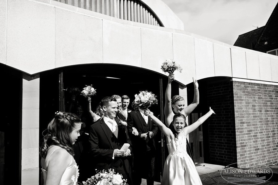 guests cheering coming out of church