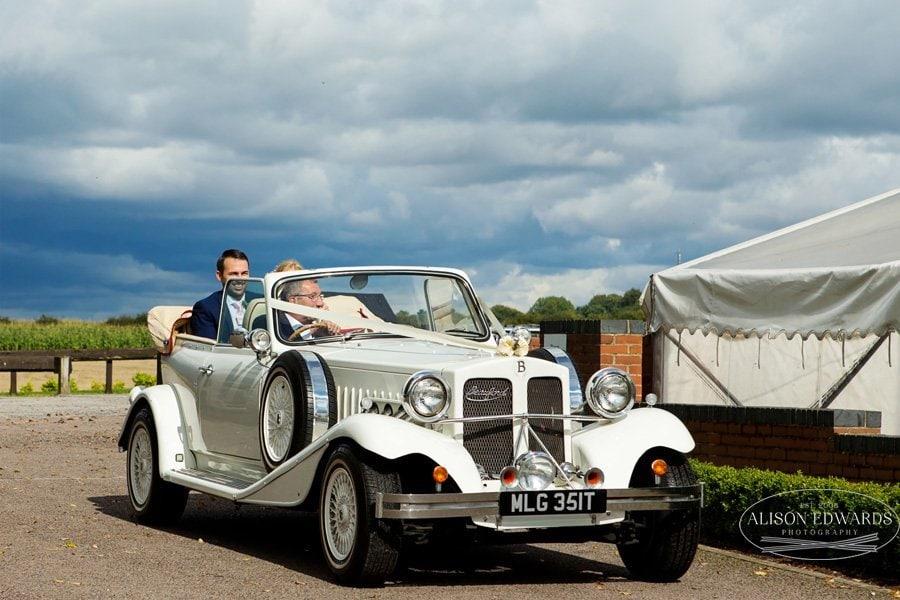 bride and groom in wedding car at Goosedale