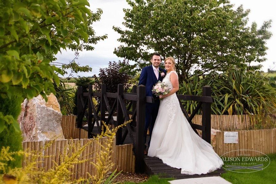 bride and groom on bridge at Goosedale