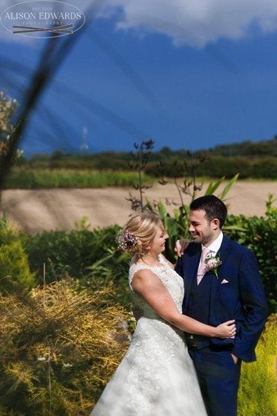 bride and groom in gardens at Goosedale