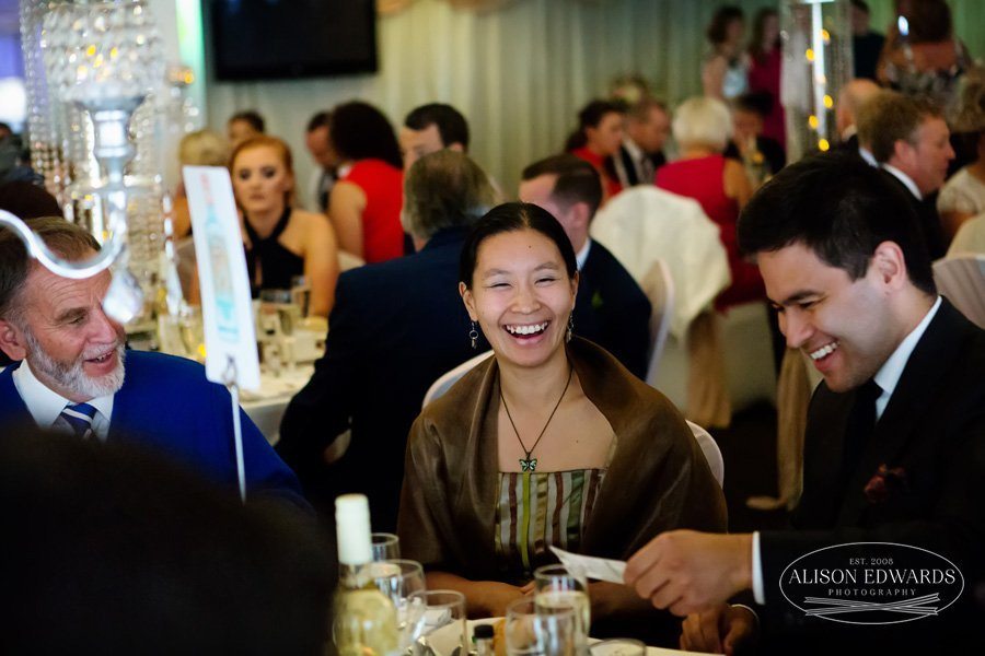 wedding guests laughing during speeches at Goosedale